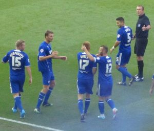 Doyle is congratulated after scoring his first goal for the Spireites