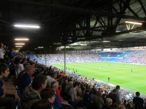 The Chesterfield fans watch the action intensely
