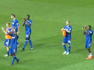The players show their appreciation to the away fans