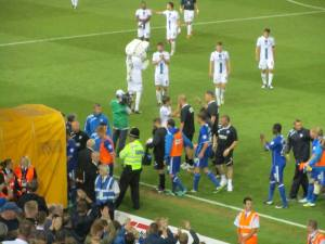 The players head down the tunnel at full time