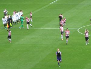 The United players applaud the fans