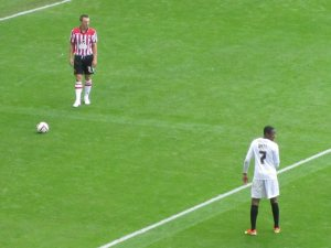 A free kick on the edge of the area for the Blades