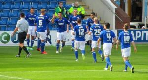 The players celebrate the first goal