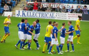 The players celebrate Hird's goal