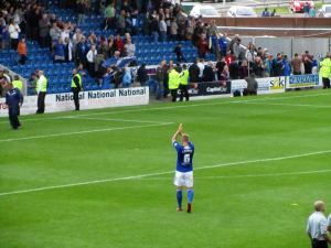Cooper applauds the Kop