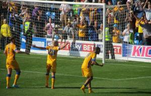 The Mansfield players celebrate the win
