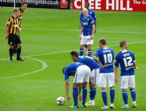 Chesterfield players stand over a free kick