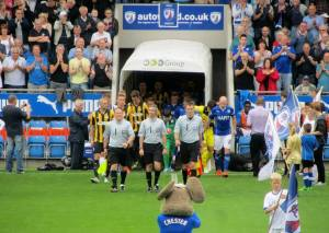 The players make their way onto the pitch
