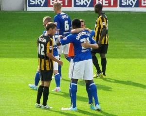 Winning goalscorer Gnanduillet gets a hug