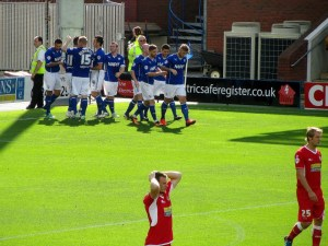 The players celebrate opening the scoring