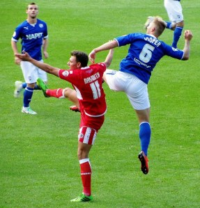 Cooper and Naismith battle for possession