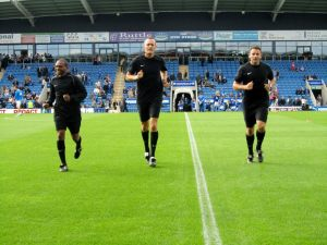 The officials warm up