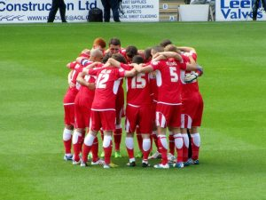 The players huddle