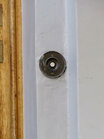 The doorbell that can be seen in the above photo
