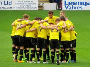 The Burton players huddle up