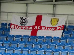 A Burton flag on the away stand