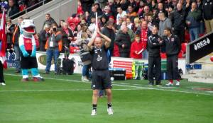 Paul Cook applauds the supporters