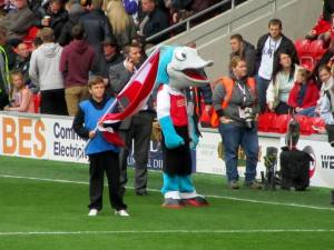 The Fleetwood mascot awaits the players