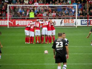 The Fleetwood players huddle up