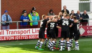 The players celebrate the opening goal