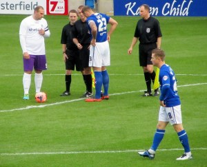 The two captains, Liam Dolman and Ian Evatt, speak to the referee