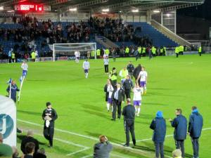 The visitors leave the pitch after the biggest game in their history