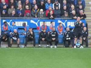 Paul Cook watches from the touchline