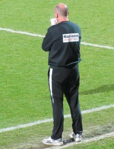 Paul Cook looks on from the touchline