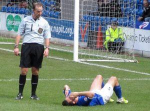 Gary Roberts goes down injured