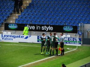 Th Argyle players protest the awarding of a penalty