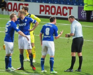 The referee awards Plymouth a spot kick