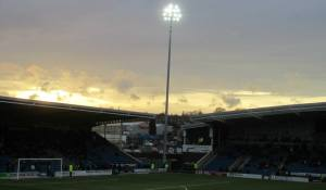Floodlights shine over the stadium