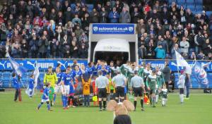 Players make their way on to the pitch