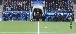 The two managers watch an early free kick