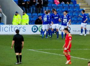 The players celebrate Roberts' opening goal
