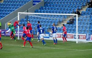 The Dagenham 'keeper smothers the ball