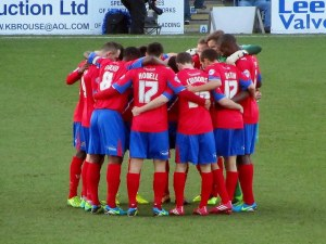 The Dagenham players huddle