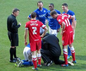 A Chesterfield player goes down injured