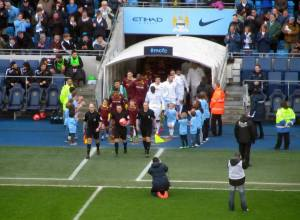 The players appear from the tunnel