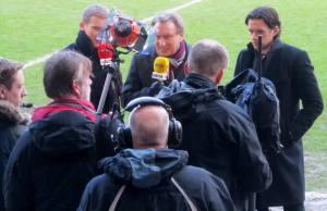 Facing the cameras