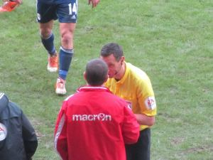 Andre Marriner has a word with an angry Nigel Clough