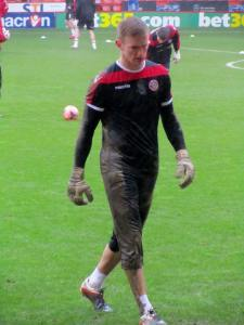 George Long gets a bit muddy in the warm up