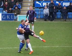 Evatt and Harrold battle for the ball