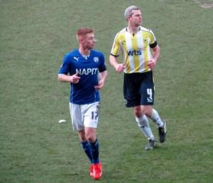 Aaron Downes marks Eoin Doyle