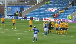 Gary Roberts stands over a free kick