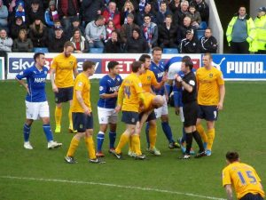 A red card is shown