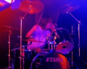 The drummer provides backing vocals