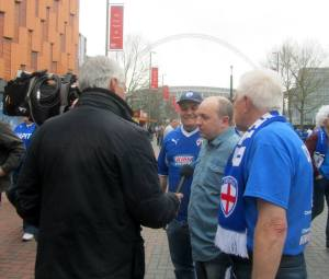 My Dad is interviewed outside the stadium