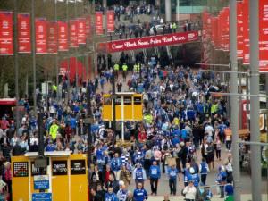 Fans make their way towards the stadium