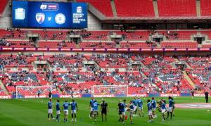 Chesterfield warm up on the Wembley turf